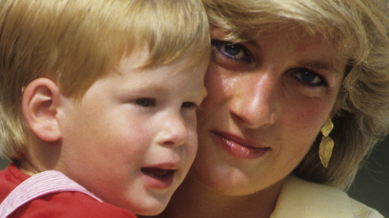 Prince Harry and Princess Diana smiling