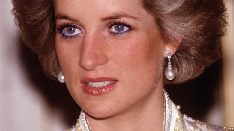 Princess Diana looking to the side at public event