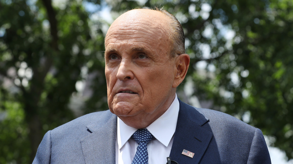 Rudy Giuliani with trees behind him