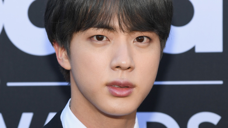 Jin of BTS blank stare