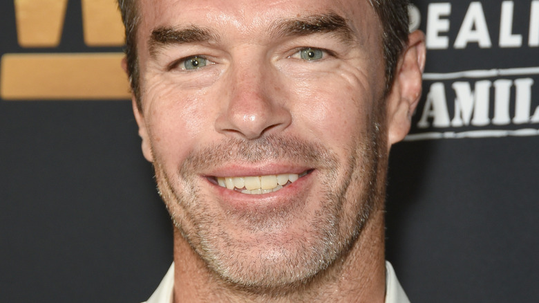 Ryan Sutter smiling at an event