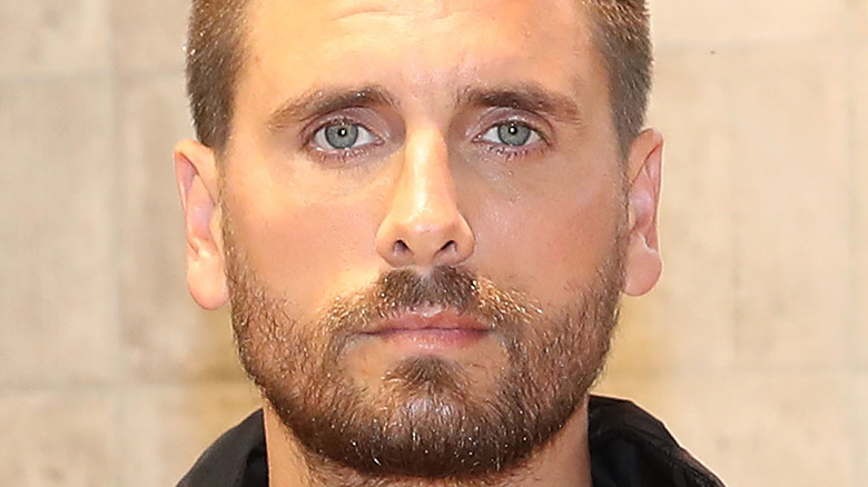Scott Disick posing as he makes a store appearance at Windsor Smith