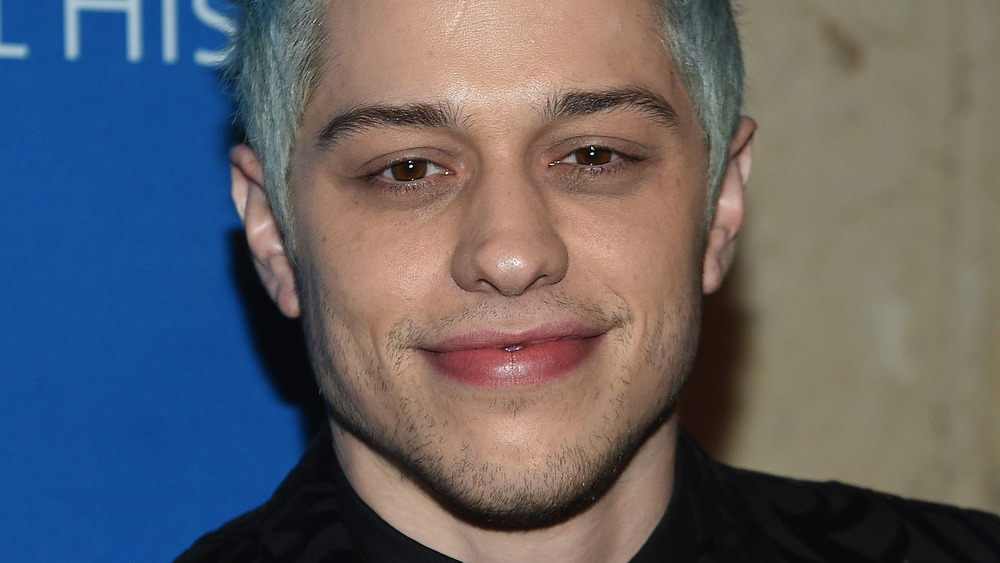 Pete Davidson with blue-green hair