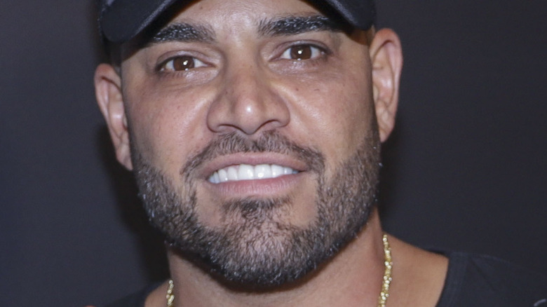 Mike Shouhed of Shahs of Sunset smiling and wearing baseball cap
