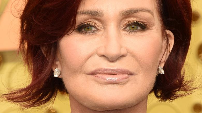 Sharon Osbourne smiles on the red carpet