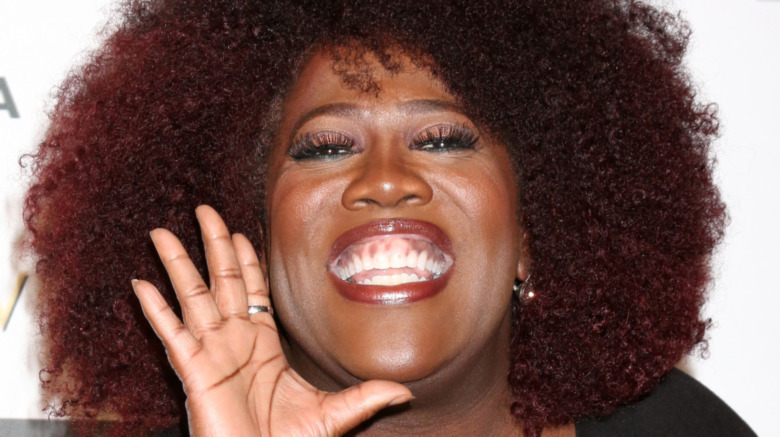 Sheryl Underwood smiling at a red carpet event