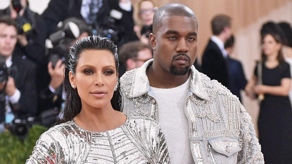 Kim Kardashian and Kanye West at the wearing matching metallic at the MET Gala