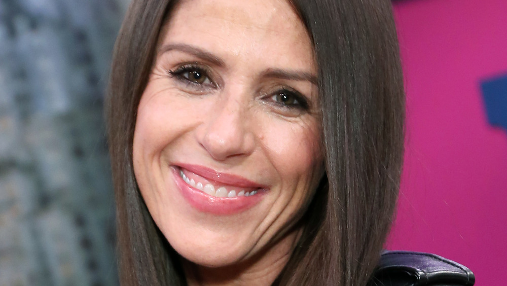Soleil Moon Frye smiling at an event
