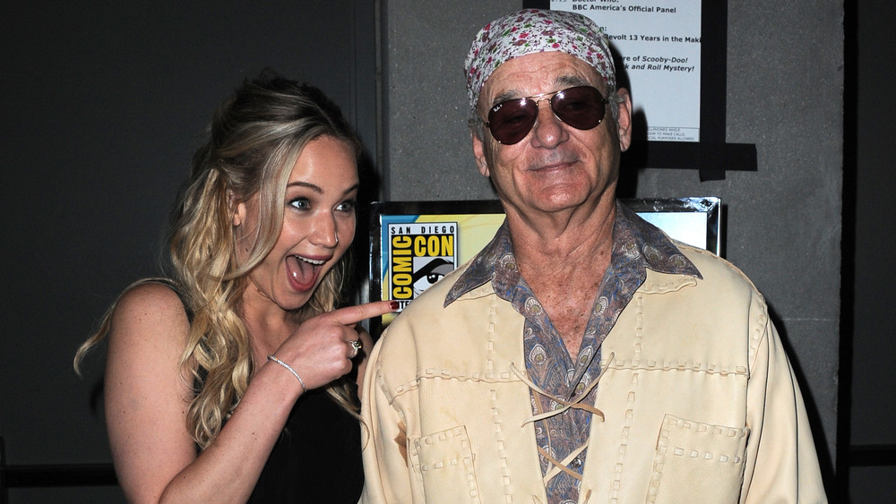 Jennifer Lawrence pointing and smiling at Bill Murray