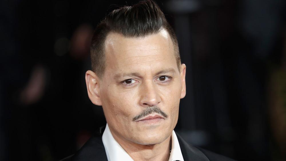 Johnny Depp looking at camera