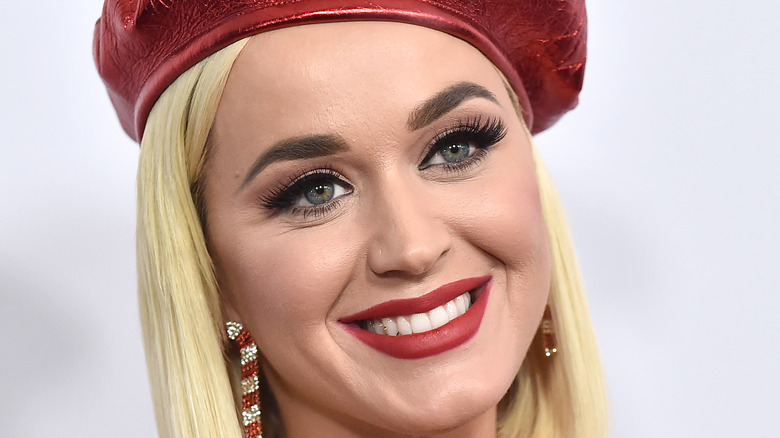 Katy Perry wearing a red hat