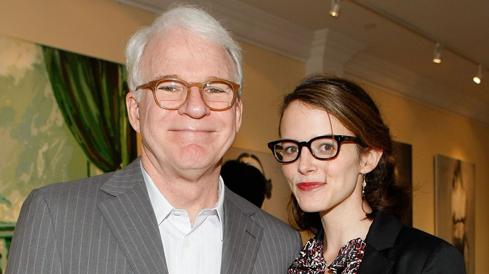 """Actor and musician Steve Martin (L) and wife Anne Stringfield attend the presentation of """"Wounded"""" curated by Carole Bayer Sager at LA Art House"""