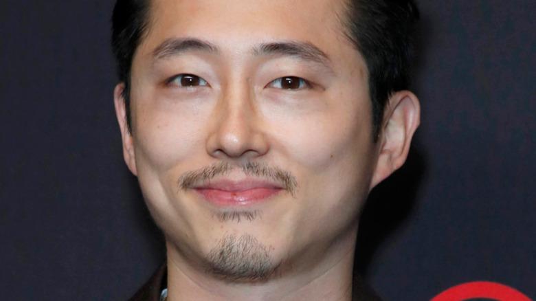 Steven Yeun smiling