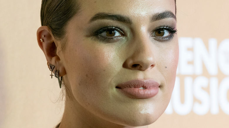 Ashley Graham with a neutral expression
