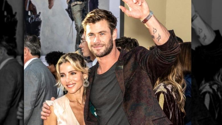 Elsa Pataky and Chris Hemsworth waving