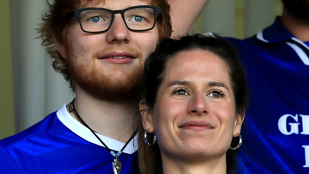 Ed Sheeran and Cherry Seaborn at the Sky Bet Championship match between Ipswich Town and Aston Villa