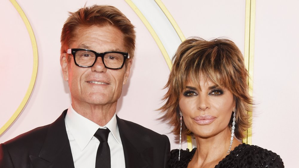 Harry Hamlin and Lisa Rinna, both wearing black, posing at a 2018 Emmys after party