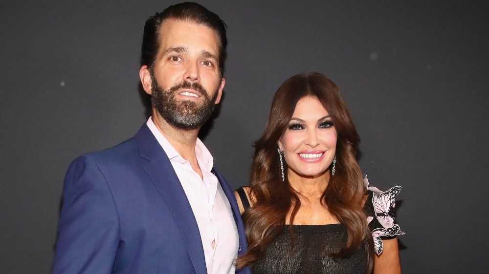 Donald Trump Jr. and Kimberly Guilfoyle smiling together