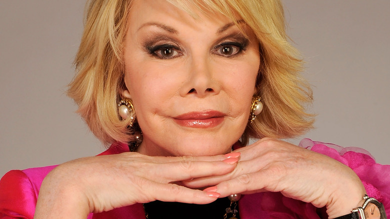 Joan Rivers resting chin on hands