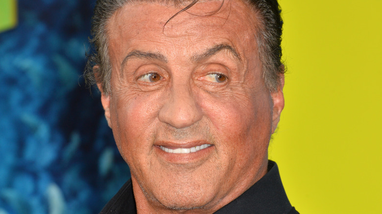 Sylvester Stallone smiling and looking to side
