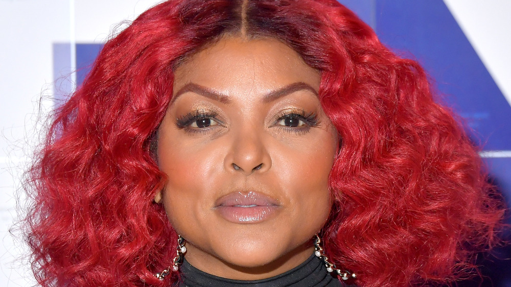 Taraji P. Henson posing with red hair at an event