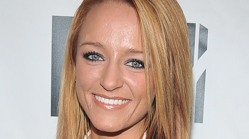 Maci Bookout smiles on the red carpet for a Teen Mom premiere