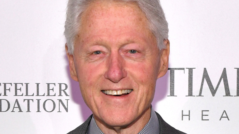 Bill Clinton smiling on the red carpet