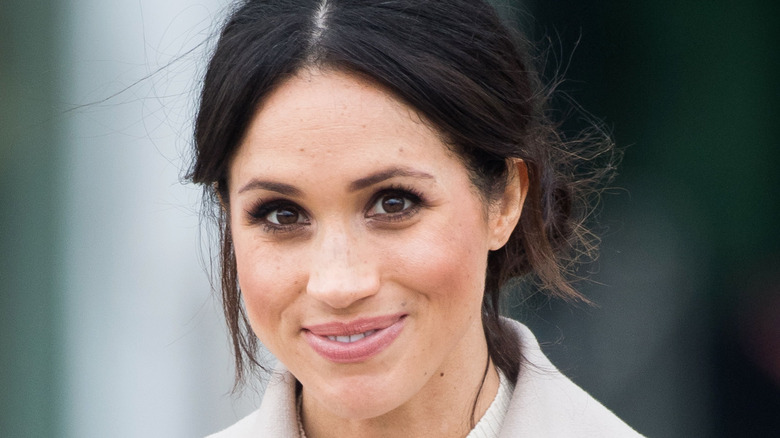 Meghan Markle smiling for a photo