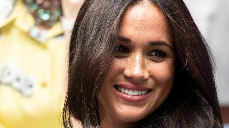 Duchess of Sussex Meghan Markle smiles at the US Open Championships