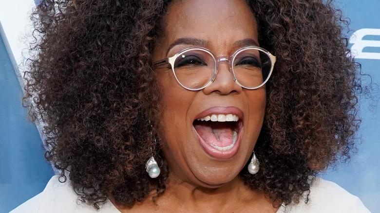 Oprah smiles big