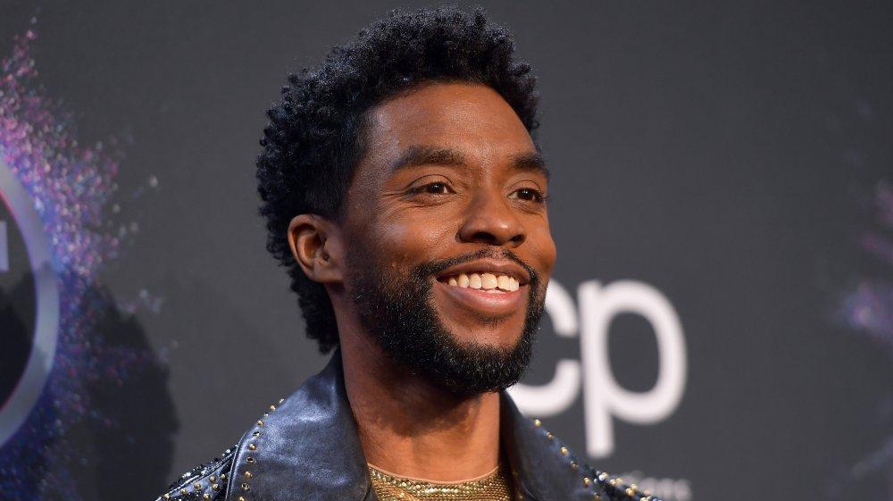 Chadwick Boseman smiling on the AMAs red carpet