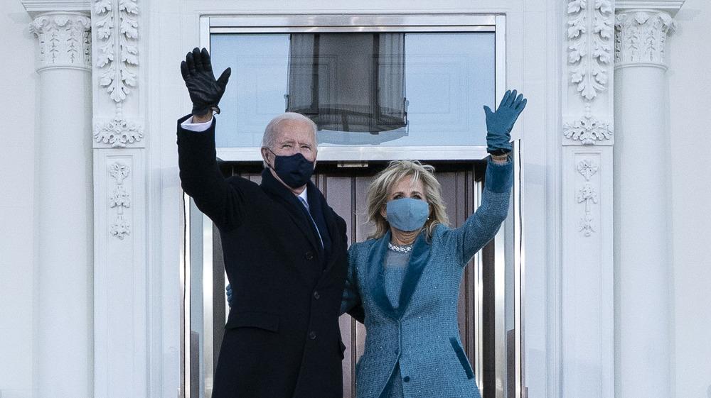 Joe Biden and Jill Biden waving