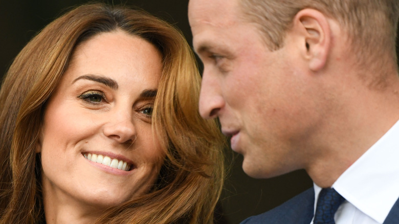 Kate Middleton smiling and Prince William talking