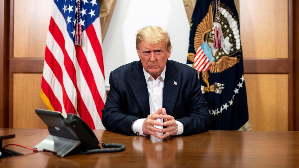Donald Trump sitting at desk