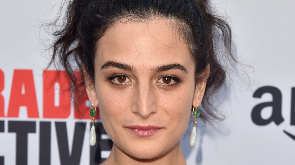 Jenny Slate with a serious expression at an event