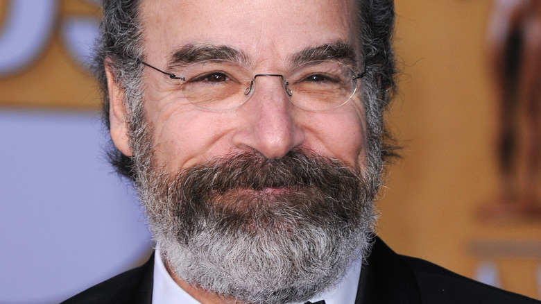 Mandy Patinkin smiles on the red carpet