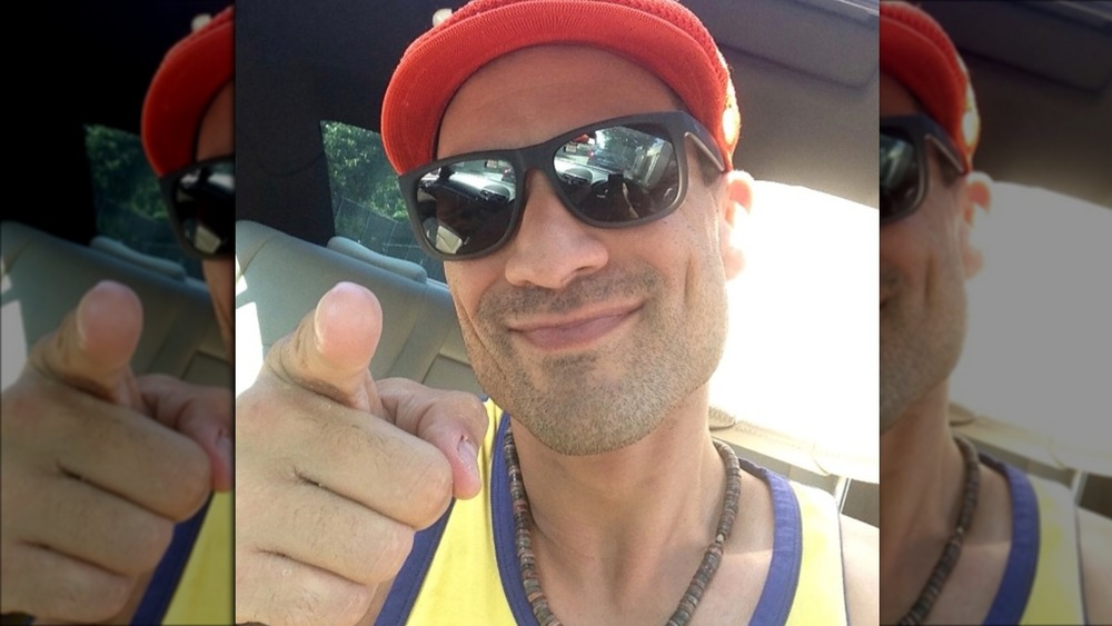 Charlie Balducci pointing in a selfie wearing sunglasses