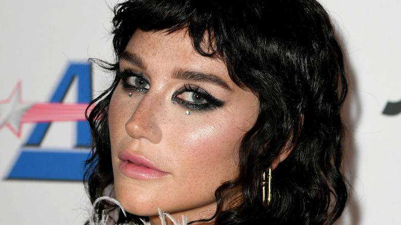 Kesha staring at camera