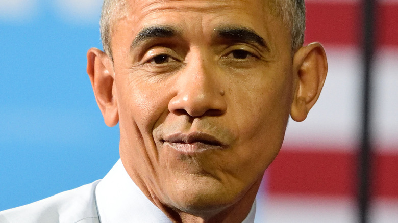 Barack Obama posing at an event