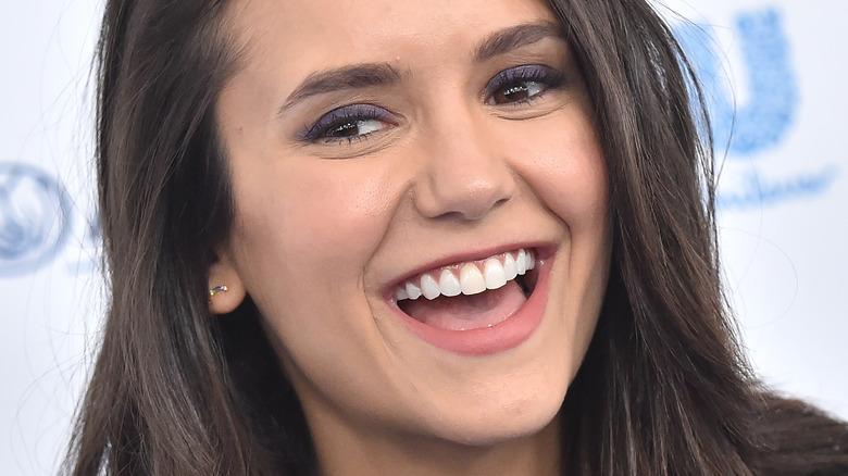 Nina Dobrev laughing in 2019