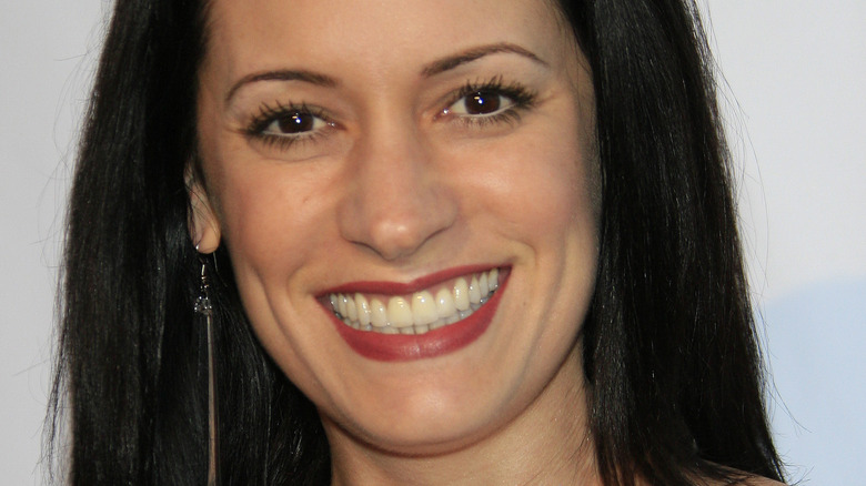 Paget Brewster looking at camera with wide smile