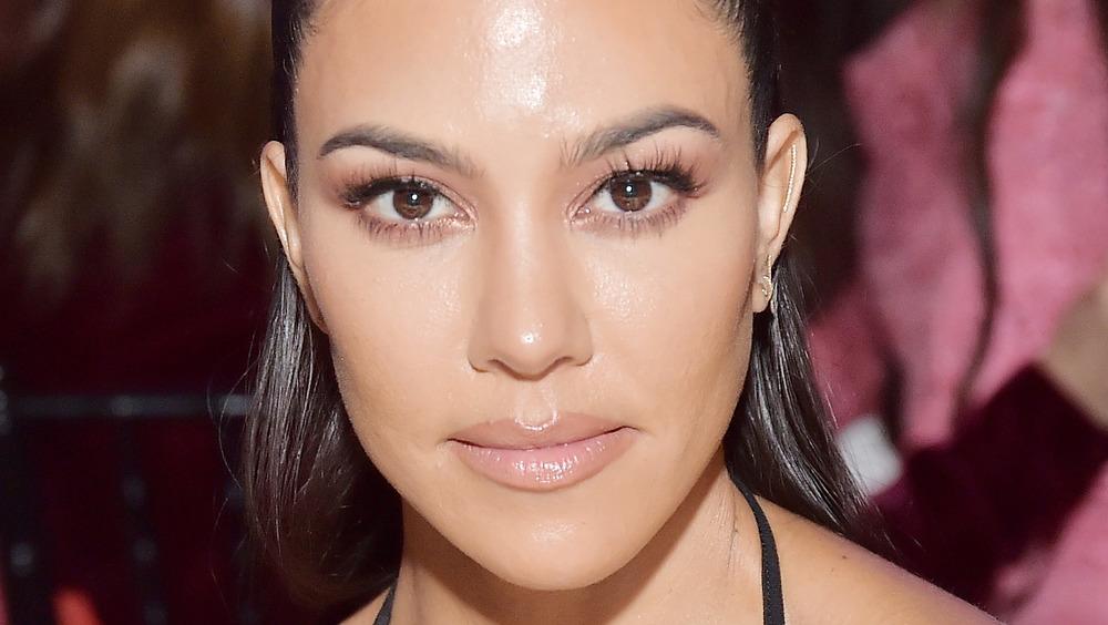 Kourtney Kardashian with a neutral expression