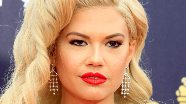 Chanel West Coast with red lipstick