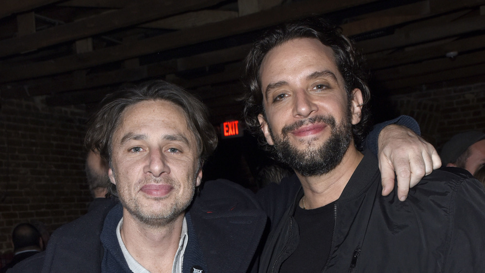 Zach Braff and Nick Cordero with their arms around one another