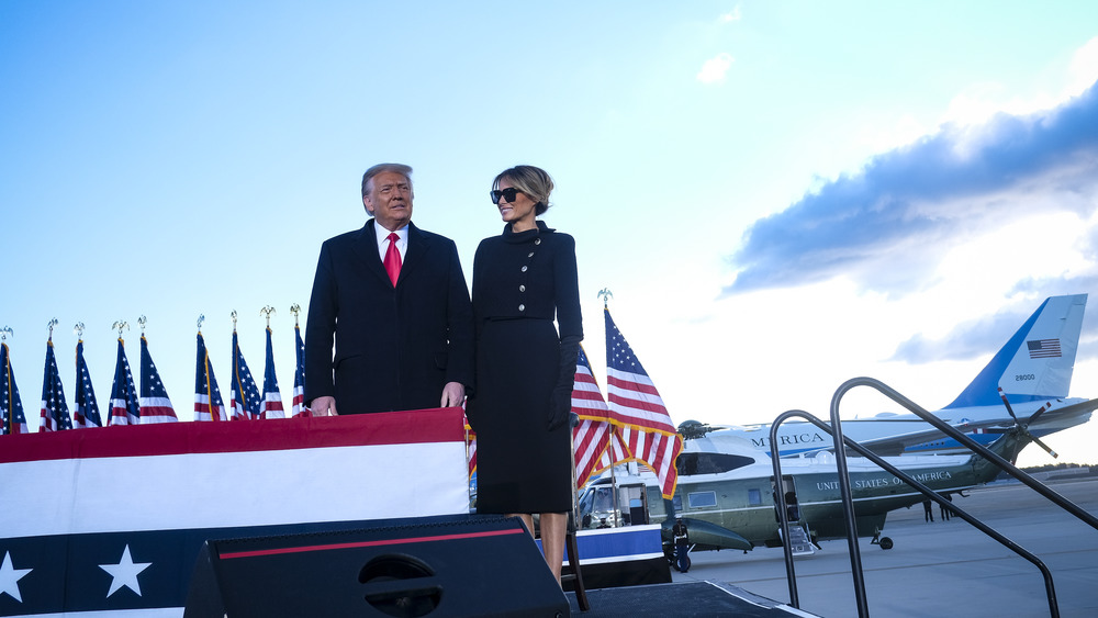 Melania and Donald Trump on a platform