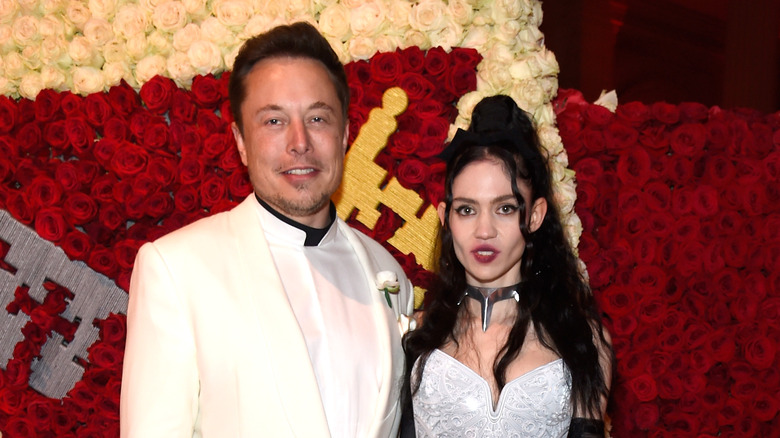 Elon Musk and Grimes at an event