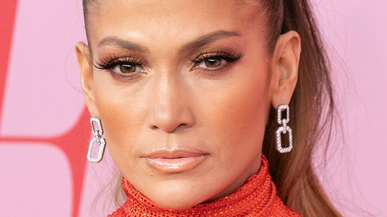 Jennifer Lopez wearing diamond dangly earrings