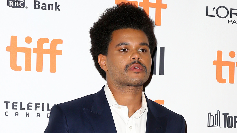 The Weeknd posing on the red carpet