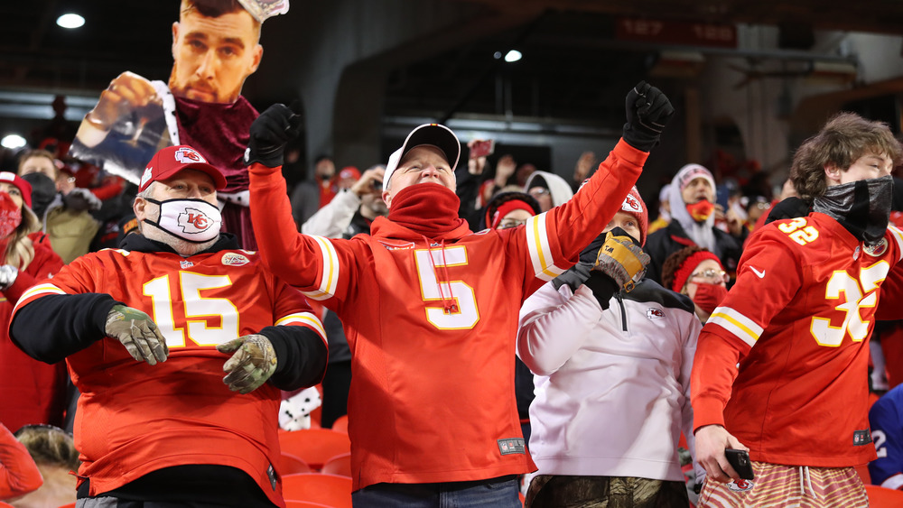 Kansas City Chiefs fans cheering at an NFL game