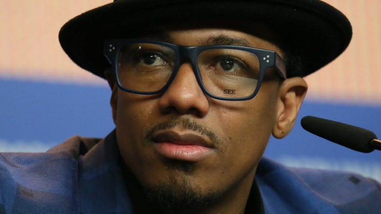 Nick Cannon in a hat and glasses